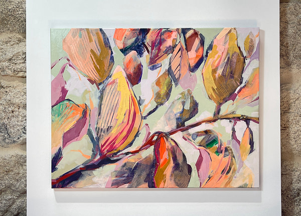 Contemporary abstract Magnolia painting in sage green, flesh and ochre tones shown on white background in front of a stone wall