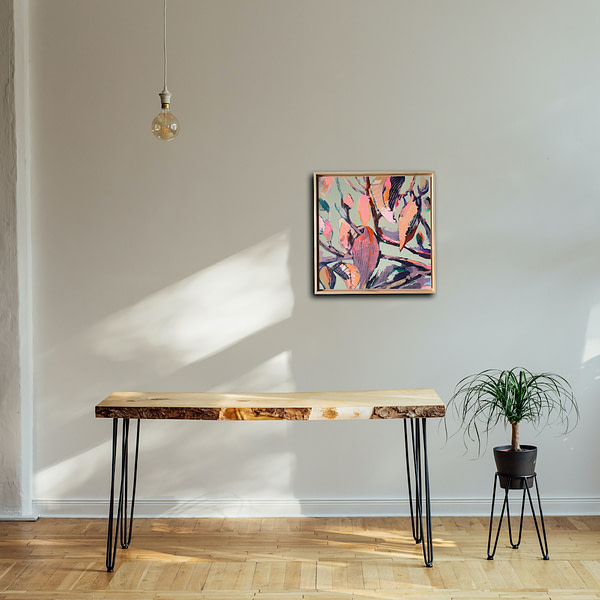 Vibrant original Magnolia painting in a natural wooden frame in a minimalistic interior
