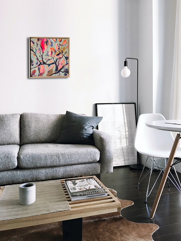 Original Magnolia painting in a natural wooden frame in a minimalistic interior