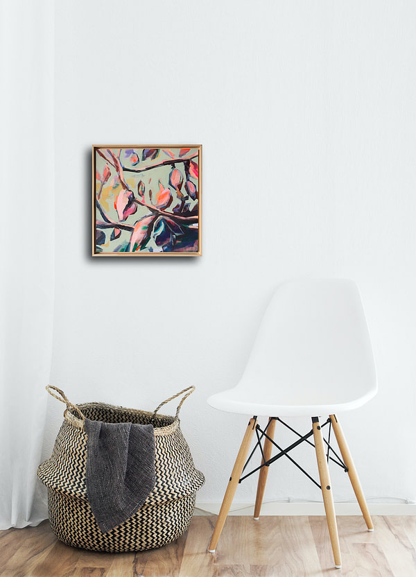Vibrant original Magnolia painting in a natural wooden frame in white minimalistic interior