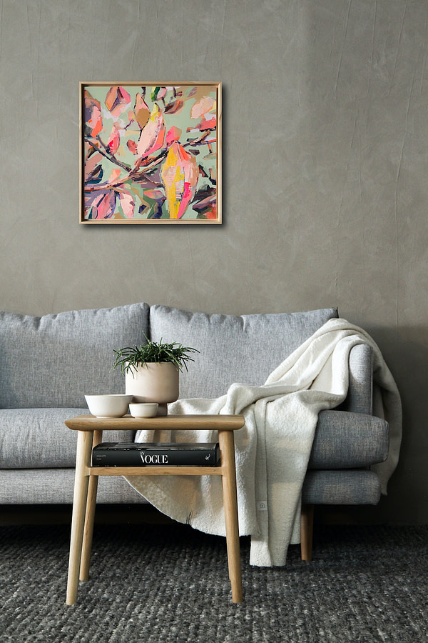 Original Magnolia painting in a natural wooden fram over a sofa in the living room